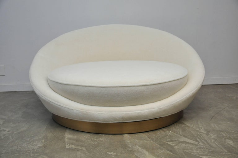 """Large-scale circular """"Satellite Chaise"""" by Milo Baughman. Large enough for two people to lounge comfortably. Fully restored. New ultra plush white mohair over brushed brass base."""