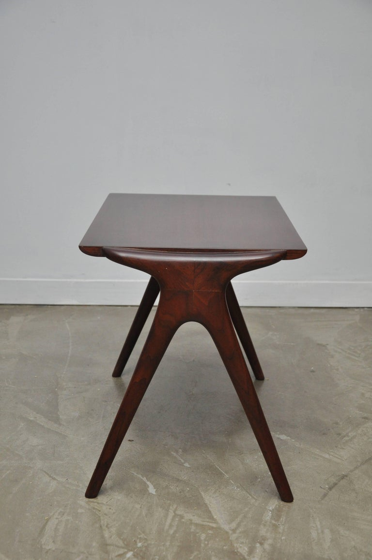 """We are proud to present this walnut side table. Beautiful sculptural form. Designed by Vladimir Kagan for Kagan-Dreyfuus, signed """"Kagan-Dreyfuss"""" on the underside. Fully restored and refinished."""