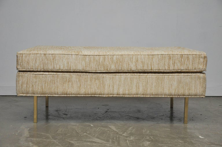 We are pleased to offer: large-scale bench ottoman by Harvey Probber. Fully restored. Beautiful new woven fabric sitting on brass legs.