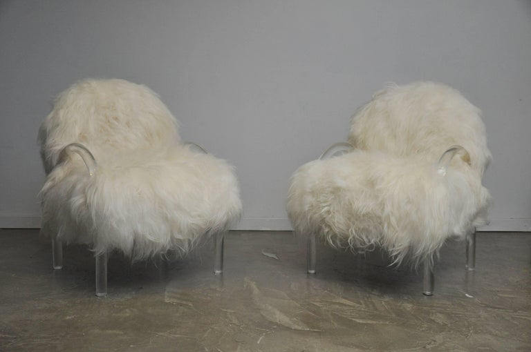 Lucite lounge chairs by Leon Pace for PACE Collection. Fully restored and reupholstered in Mongolian lamb.