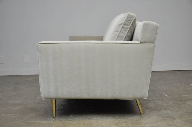 Fully restored in beautiful fog grey mohair over polished brass legs. Sofa designed by Edward Wormley for Dunbar, circa 1950s.
