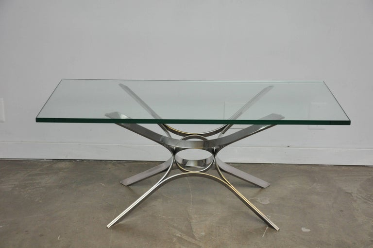 Sculptural form chrome base coffee table with glass top. Designed by Roger Sprunger for Dunbar, circa 1970s.