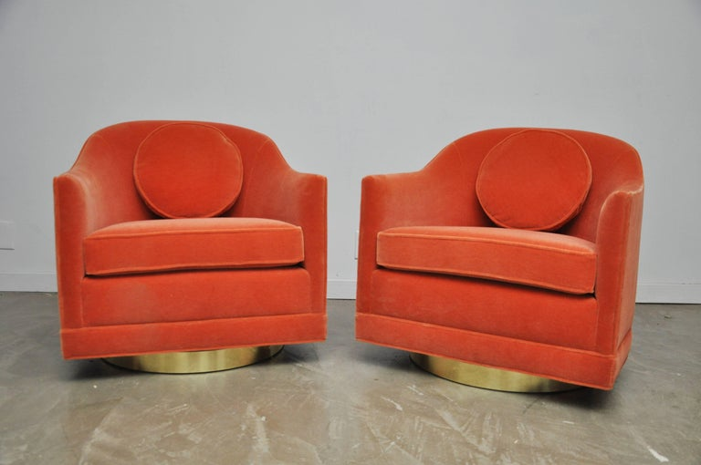 Beautiful pair of swivel chairs by Harvey Probber. Fully restored and reupholstered in coral mohair over brass swivel bases.