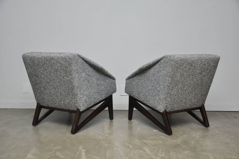 Italian lounge chairs with sculptural from walnut bases with diamond form arms. Fully restored and reupholstered in new blue or white weave fabric.