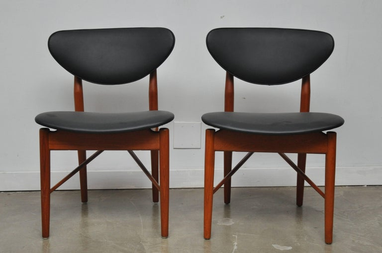 Mid-Century Modern Pair of Finn Juhl NV-55 Dining Chairs For Sale