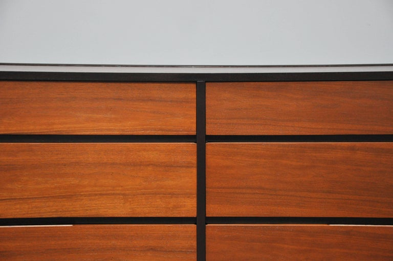 Beautiful six-drawer dresser by Edward Wormley for Dunbar, circa 1960. Dark espresso mahogany cases with natural walnut drawer fronts and top, giving a striking contrast. Fully restored and in excellent condition.