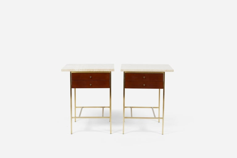 Pair of brass frame nightstands or side end tables with mahogany cases and travertine tops. Designed by Paul McCobb for Calvin Furniture. Fully restored/refinished.