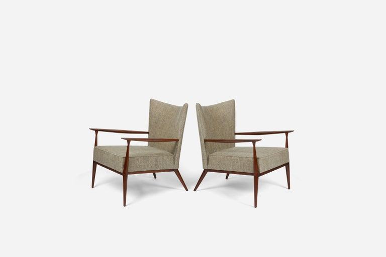 Handsome pair of Paul McCobb designed lounge chairs. Model #1328 for Directional Furniture. Fully restored. Refinished walnut frames, new upholstery.