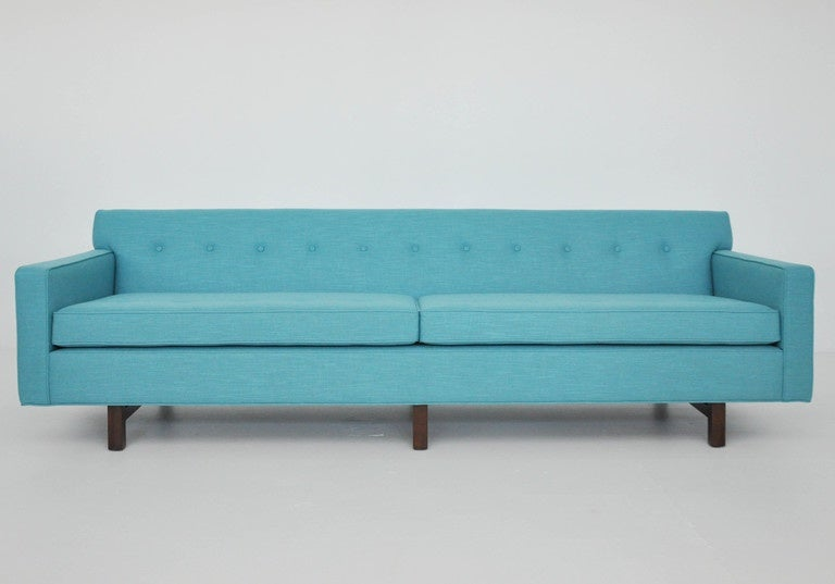 Long four-seat sofa by Edward Wormley for Dunbar. Fully restored. New turquoise upholstery over refinished bases.