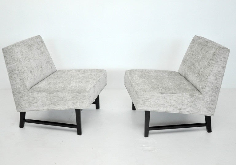 Pair of slipper chairs designed by Edward Wormley for Dunbar. Newly upholstered over dark espresso finish mahogany bases.