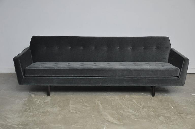 Rare flare armed bracket back sofa by Edward Wormley for Dunbar. Fully restored, refinished and reupholstered in charcoal velvet. Espresso tone on bracket back frame with brass screws.