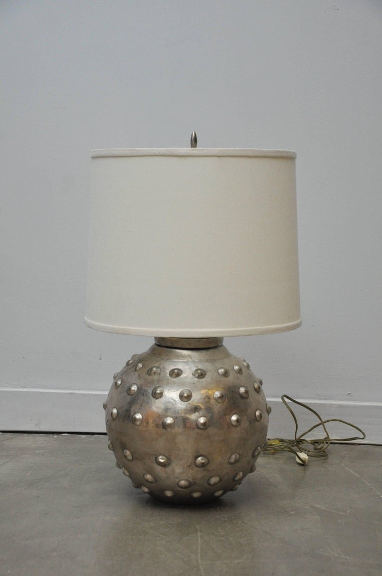 Silvered brass lamps by Sarreid Ltd. Brass clad orb base with studded texture, finished in silver tone. Measures: 24
