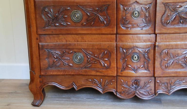 French 19th century French walnut commode beautifully carved with olives and olive branches. Provence, France.