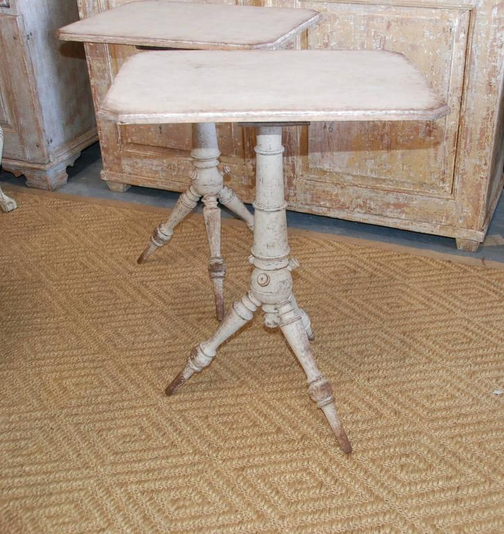 19th century pair of Swedish pedestal tables in soft cream white color. Lovely carved faux bamboo leg design.