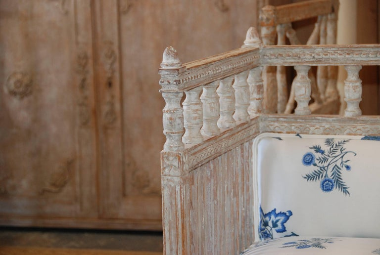Beautiful 18th century Swedish period sofa scraped down to the original white color. Lovely carved sides, back and apron. Newly upholstered in crisp blue and white Brunschwig & Fils fabric.