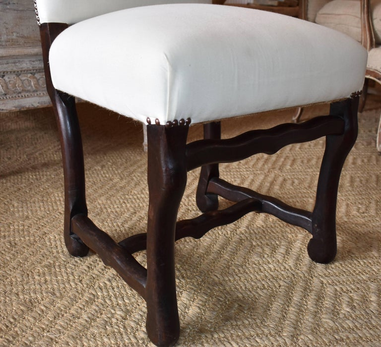 Very nice set of ten Os de Mouton dining chairs from Normandy, France. Sturdy and very comfortable.