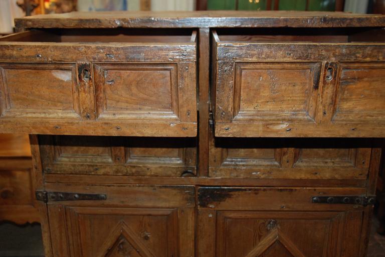 17th century Spanish chestnut Armoria, Madrid, Spain. Lovely raised paneled doors and drawers with original iron hardware and locks.