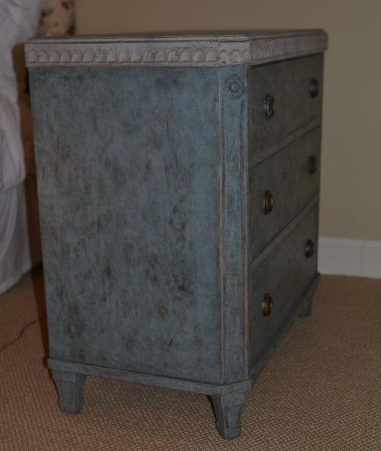 Pair of antique Swedish Gustavian painted chests in lovely blue paint with carved border around beautiful faux grey marbled top. Classic square tapered legs, brass hardware and raised panel detail.