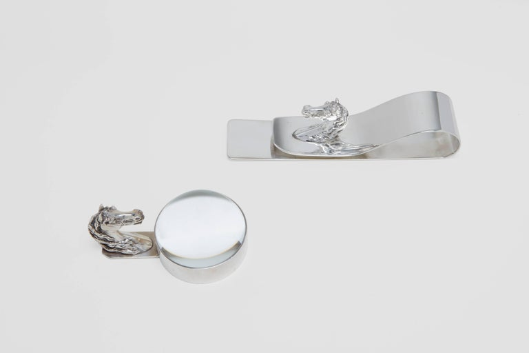 A silver plate and crystal pair of desk accessories adorned with a fine casting of a horse head. These fabulous pieces have been expertly carved in France, and were then sent out to retail at Hermès boutiques. The first piece is a stunning and large