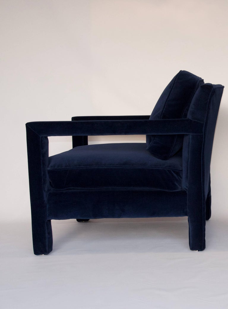 This fully upholstered Parsons style chair was made in the style of Milo Baughman by Bernhardt. The chair has been newly upholstered in a high quality blue velvet. Both the back and seat cushions are removable. Extremely comfortable and in excellent