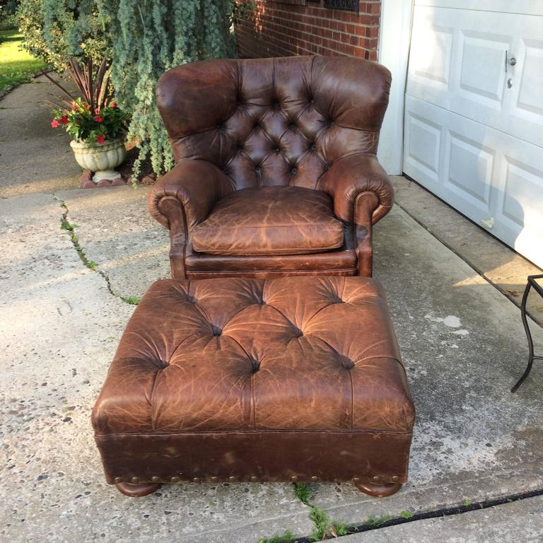 Supple Brown Leather Big Manly Tufted Club Chair And Matching Ottoman With Large Bronze Brass Nailhead