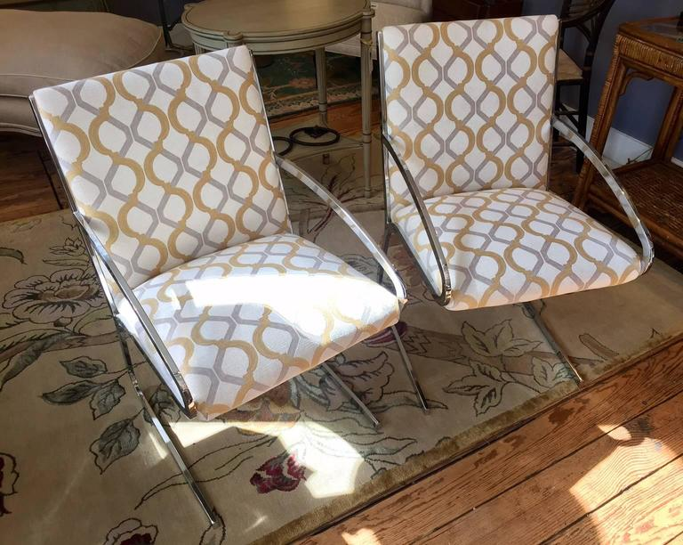 Sleek pair of armchairs having elegant chrome frames, newly upholstered in a schnazzy geometric chenille fabric.  SW.