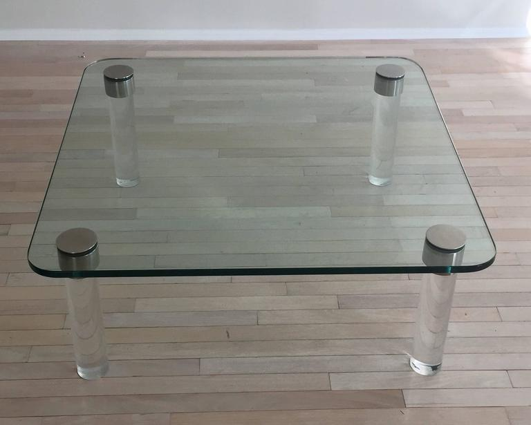 Beautiful pace coffee table with chrome trim and Lucite legs. Glass is 3/4