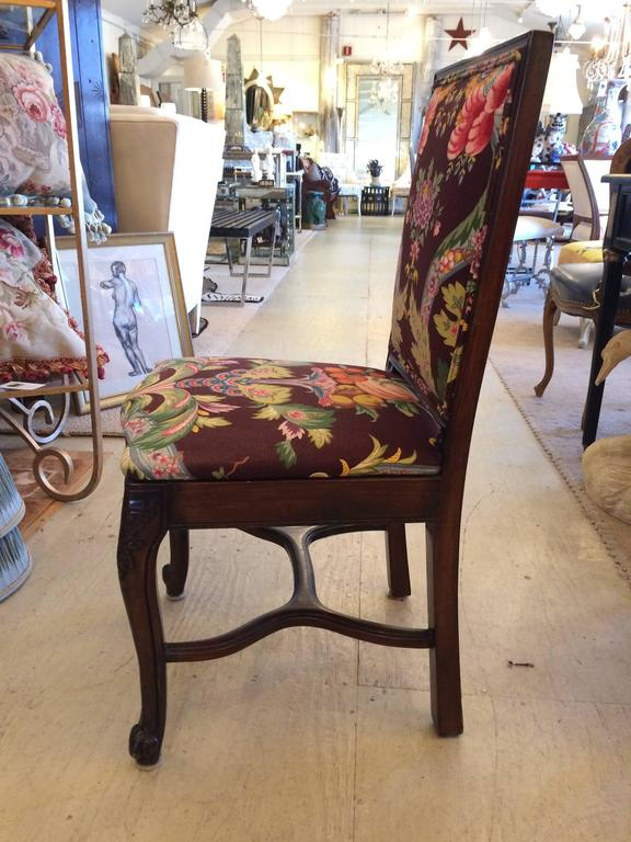 Wonderful French country carved mahogany dining chairs with old world charm, updated with zippy Brunschwig and fils upholstery.