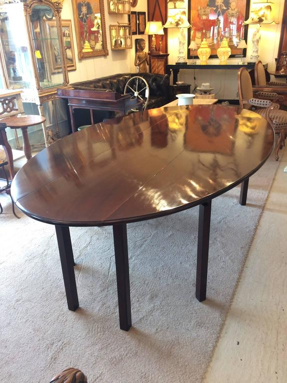 Sublime solid dark mahogany 8 foot gate leg table, with beautiful oblong shape when fully open, with two drop leaves, shrinking to a narrow 16.5 D when both leaves are down. Could be used as a sofa back table or very long console.