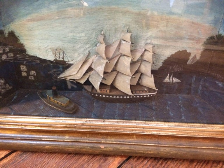 Incredibly crafted handmade antique diorama of a sailing vessel, very 3 D with other boats in the foreground and a graveyard and other details painted in the background. Original old glass with some minor bubbles, and original wooden box frame