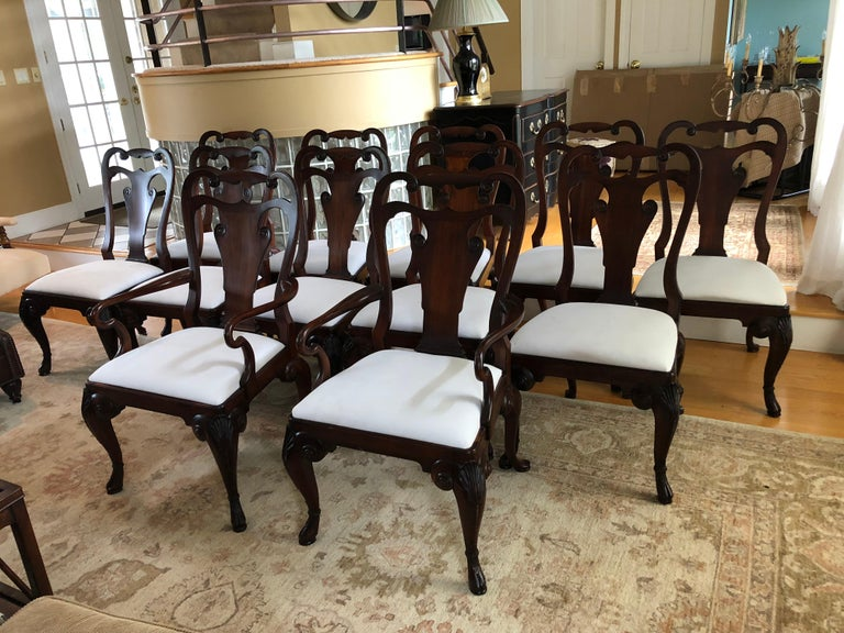 Set of 12 rich mahogany Ralph Lauren for Henredon Beekman dining chairs that includes 2 arm chairs and 8 side chairs. Timeless, Classic style and very comfortable. Seat padding is fully intact and in great condition on all chairs but they need