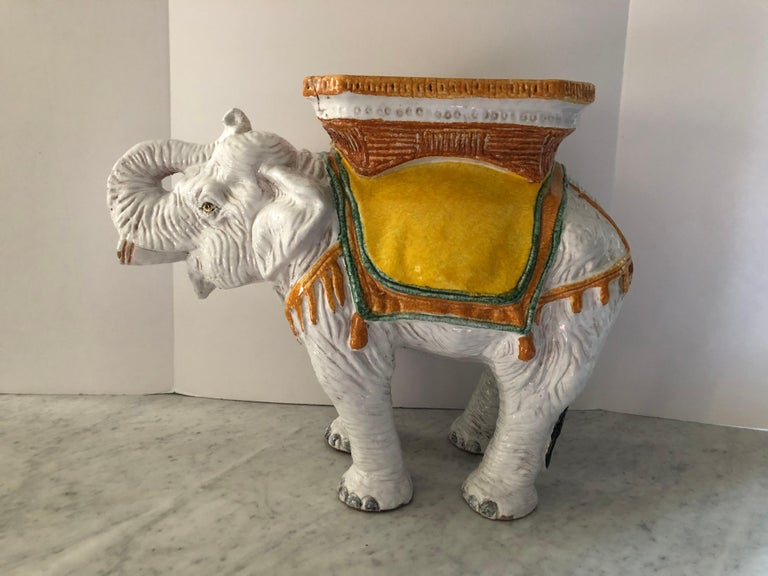 Wonderful coloration in this elephant inspired vintage garden seat. The trunk on the elephant is posed upward which means good luck. Great used as a side or drinks table. Made in Italy.