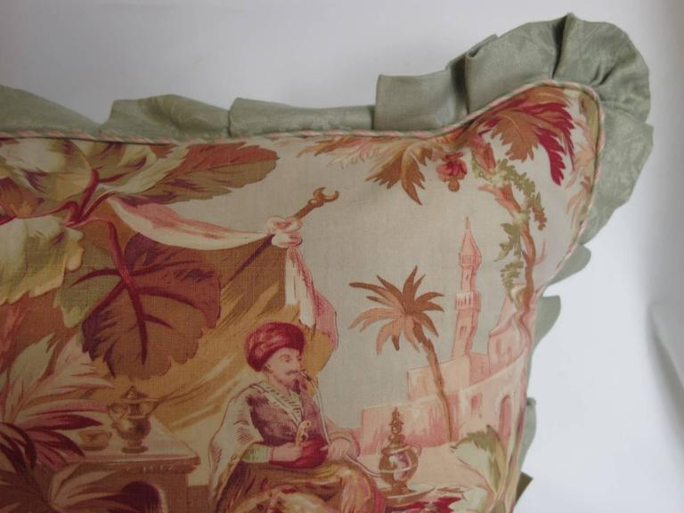 A pillow made from a circa 1880s scenic printed cotton, in muted shades of pink and sage, edged and backed with hand dyed linen damask, with a bow back closure, includes a down insert. Excellent condition, two available.