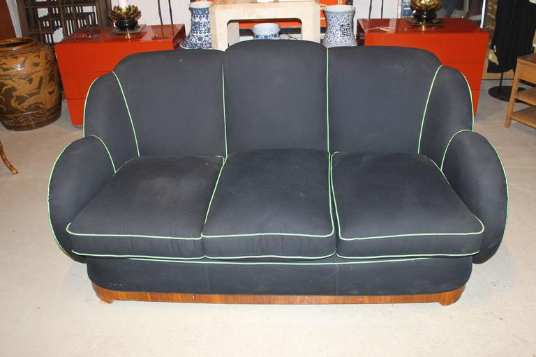 Recently re-upholstered but with one minor small hole on the upholstery. Black/blue fabric with green piping. Sofa is solid and heavy. All cushions are in very good shape. Please see pictures for condition.  We also provide re-upholstery service