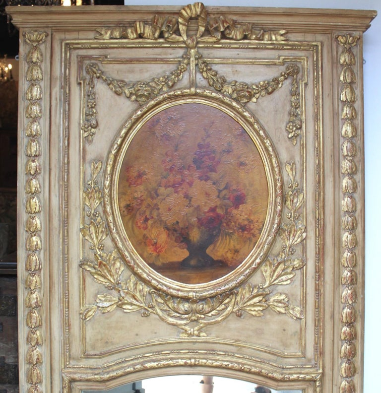 Elegant large 19th century carved wood, gilt and painted trumeau mirror. With floral painting. Silvered mirror. Very good condition. Yellowed varnish on painting. (Could be cleaned at buyers request).