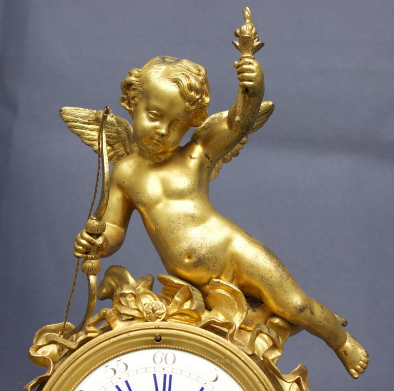 Mid-19th Century French Louis XVI Figural Clock in Chased and Gilt Bronze For Sale