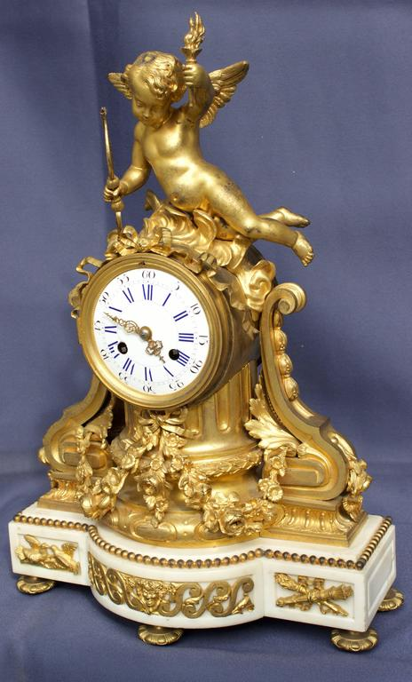 A superb mid-19th century. Clock with beautifully chased and ormolu gilded bronzes. Rest on a white Carrara marble base supported by five nice adjustable toupie feet and decorated by gilt pearls on top, two doves (symbol of love) and fasces bundles