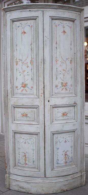 Superb and extremely rare Quot; Encoignures & Quot; (French name for corner cabinets). Rounded facade with folding doors, each having three arched panels in a double molding frame. Typical for the period, left door closes by a small latch hook and
