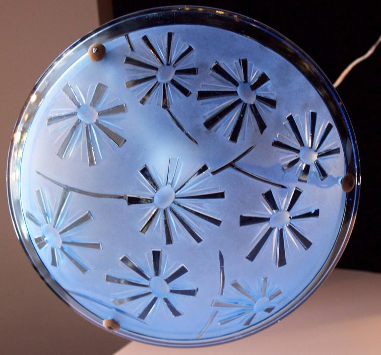 "Skyblue thick molded glass pendant with a pressed geometric pattern like sunrays on the convex side .Silk covered original fixtures. Rewired for the USA with a single central bulb. Marked "" France"" on the glass edge."
