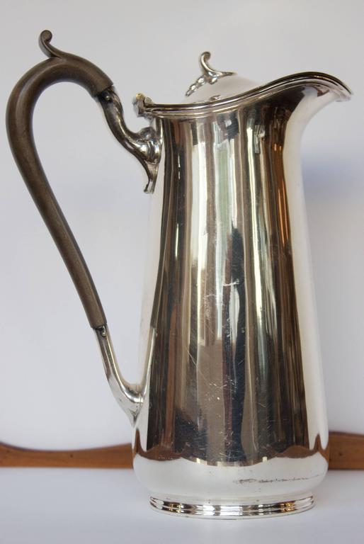 "Interesting shape for this pot made in Sheffield at the end of the 19th century. by electroplating nickel with silver (EPNS mark on bottom). Nice scrolled wood handle. Made by ""Cooper Brothers"" as marked on bottom. The electroplating technique at"