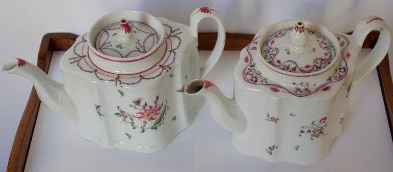 Lovely pair of antique 18th century. Teapots probably from Luneville. Handmade and painted with their lovely and delicate floral parers and venter tops. Perfect for a spring table.