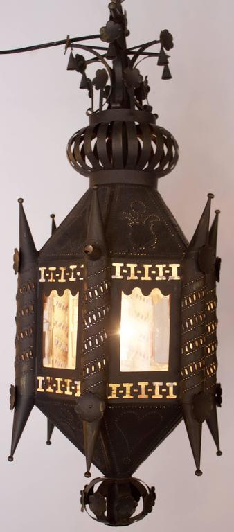 Pair of hall lanterns with pierced and punchwork decor in black painted tin and in hexagonal shape, each side having a glass window. They were fitted with candles and now have been electrified with USA std.