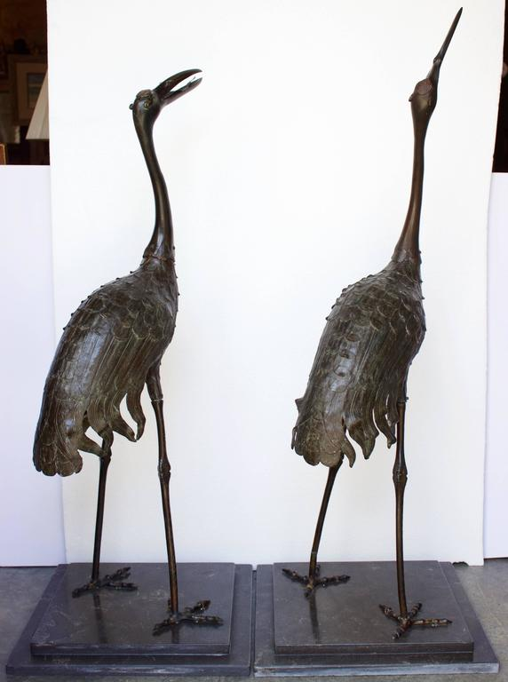 "Pair of Japanese Meiji Period Bronze ""Red Crowned"" Cranes In Good Condition For Sale In Charleston, SC"