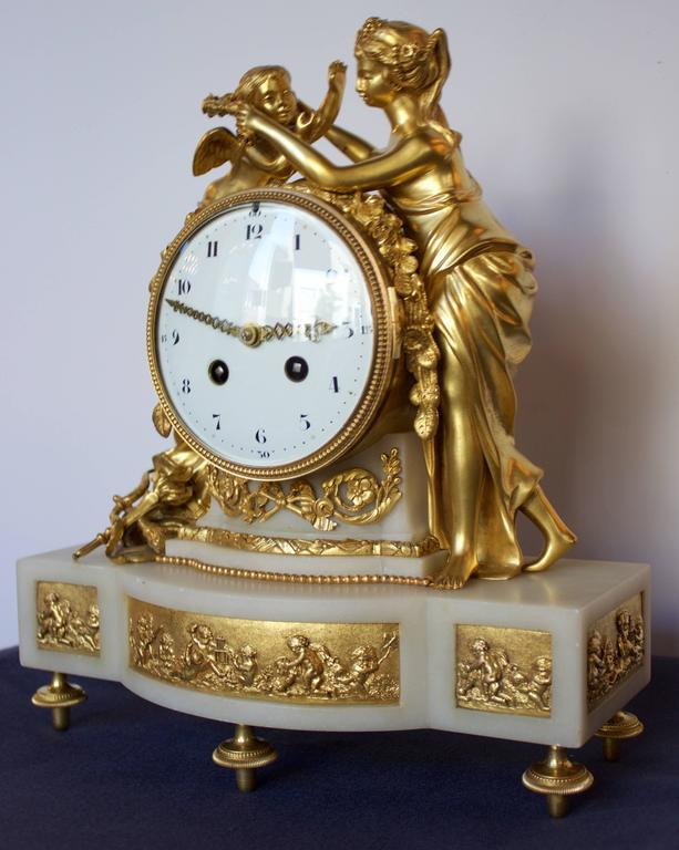 Magnificent and refined clock made under Napoleon III time after a model registered by Francois Vion (Bronze Master) in 1786 in Paris, under Louis XVI reign.  Structure in finely chased and gilded bronze figuring the allegory of Psyche enlacing her