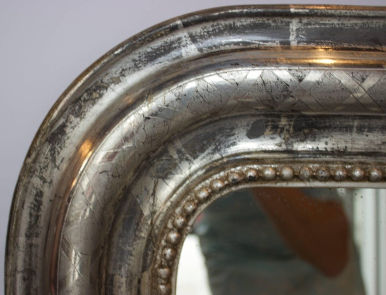 Hand Carved and Silver Gilt Louis Philippe Mirror with Lattice Carving and a Row of Carved and Silver Gilt Pearls. Mirror has its original Silvered Glass Mirror and Wooden Back.