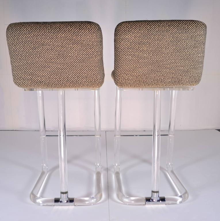 Pair Of Lion In Frost Swivel Bar Stools In Lucite Circa