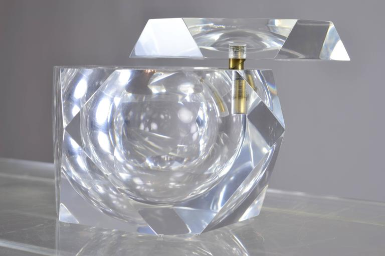 Very fine quality fire polished Lucite ice bucket with heavy swivel top. Faceted design. Two available.