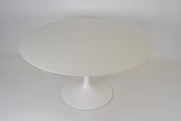 "A very nice example of an early Saarinen table. Great size at 54"". Base has been restored to excellent condition. Original laminate top is very, very clean with almost no wear."