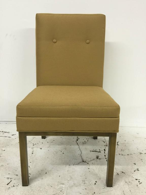 Set of Four Stendig Dining chairs, Each one with upholstered back and seat on patinated bronze legs. The backrest is 19.5