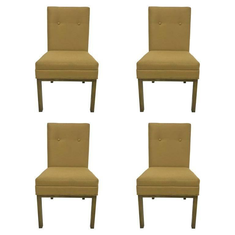 Brass Set of Four Stendig Dining Chairs For Sale